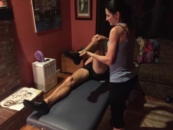 Annemarie Fullem, PT examining a runner at home