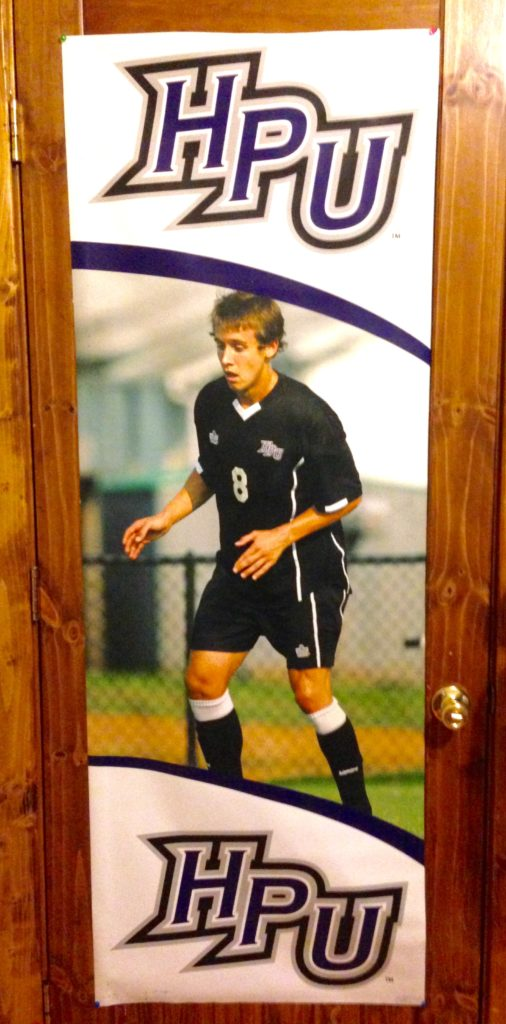 Cole's nearly life-sized player poster from High Point