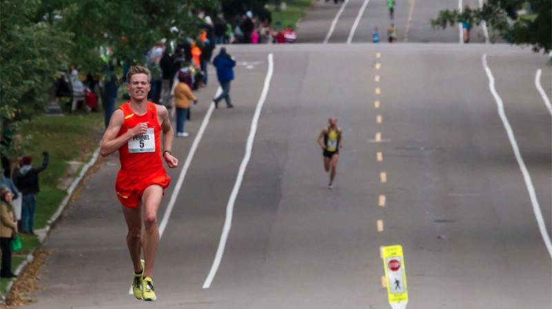 Tyler Pennel pulling away from the field in the 2014 USA Marathon Championships. Photo: Paul Phillips/Competitive Image