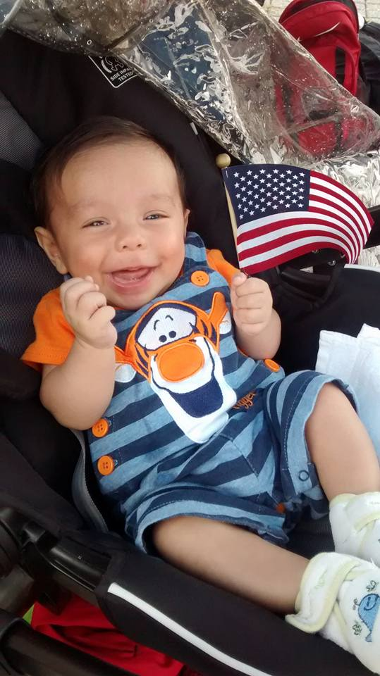 Matthew was all smiles when I put the USA flag that was given to me for winning the event, in his stroller.